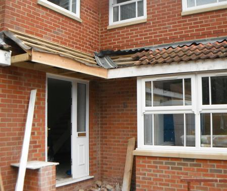 Repositioning of the front entrance to create a larger bay window in the lounge with L shape canopy over entrance and bay