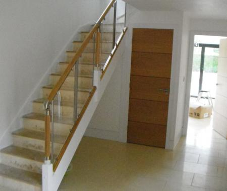 Re-positioned staircase with oak and glass ballustrade