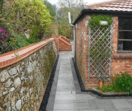 original lime mortar retining wall rebuilt and restored to its former glory