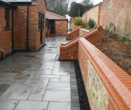 retaining wall has been rebuilt to create a useful raised bed