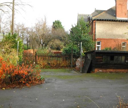 Front garden showing dilapidated brick and timber shed
