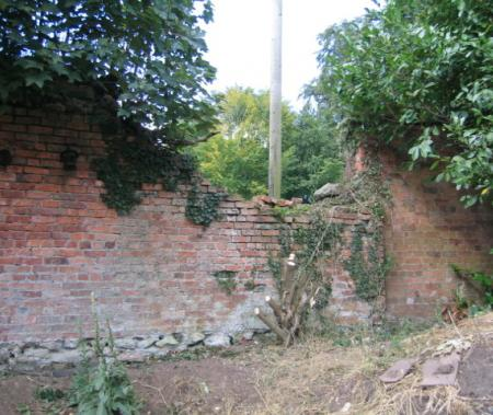 Part of the collapsed boundary wall