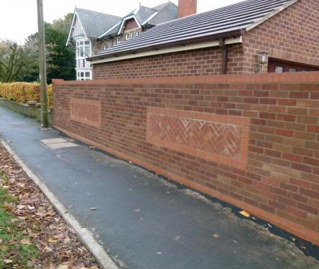 Front wall with ornate brickwork relief