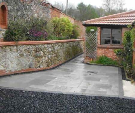 Extensive renovation of lime mortar wall and hardlandscaping